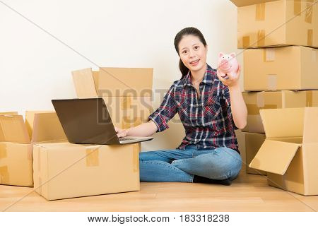 Woman Research For Moving With Money Piggy