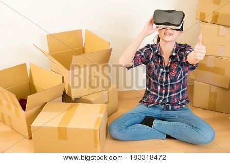 Woman Thumbs Up Working With Vr Headset