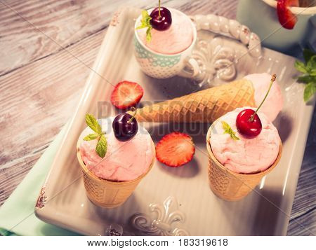 Home Made Strawberry Ice Cream Served In Cones