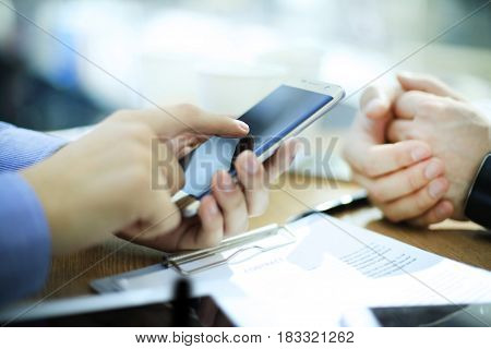 Technologies make life easier. Close-up of man holding digital tablet while mobile phone and laptop laying on foreground