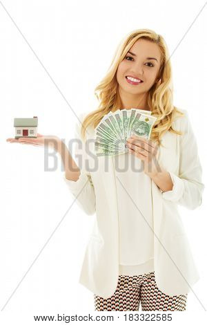 Beautiful young woman holding bills and house model - real estate loan concept