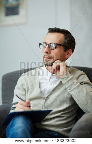 Pensive counselor listening to client