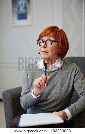 Pensive senior woman during psychological session