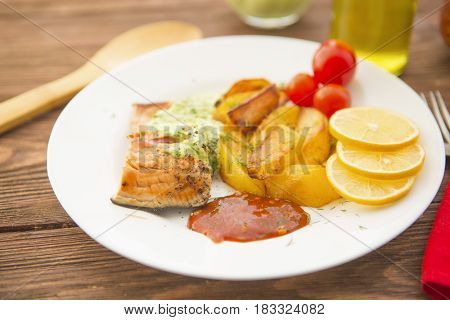 Baked Salmon With Potatoes And Cream Sauce