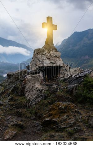 GEORGIA KAZBEGI Orthodox cross near Caucasus mountains.