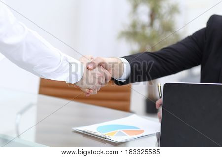 Close up view of business partnership handshake concept. Photo of two businessman handshaking process. Successful deal after great meeting.