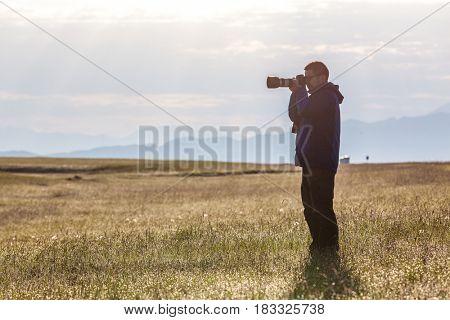 photographer take photo in grassland