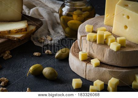 Cheese Platter Of Chopped Swedish Hard Cheese And Sliced And Italian Pecorino Toscano) On Wooden Boa