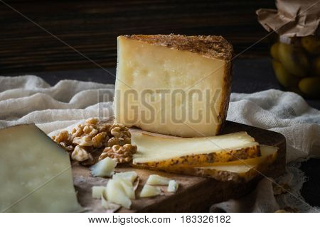 Cheese Platter Of Chopped Spanish Hard Cheese Manchego And Sliced Italian Pecorino Toscano) On Woode
