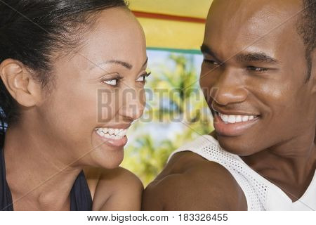 Multi-ethnic couple smiling at each other