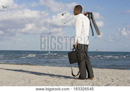 African businessman standing on beach