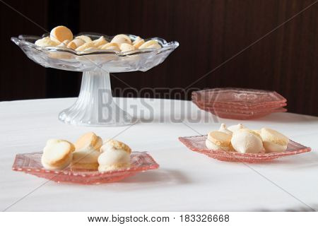 Vase With Cookies On A Round Table. Pink Shallow Decorative Dish With Biscuits.