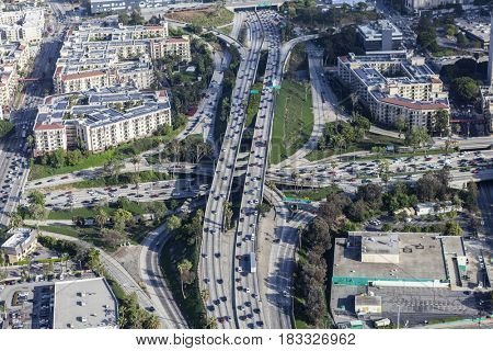 Los Angeles, California, USA - April 12, 2017:  Afternoon aerial view of the Hollywood 101 and Harbor 110 freeway interchange in downtown LA.