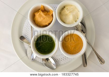 Overhead Of Dip Sauces And Dressing In Bowls On Plate