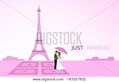Just married - wedding. Bridal couple in Paris with umbrella. Eiffel tower in the background. Pink shade.