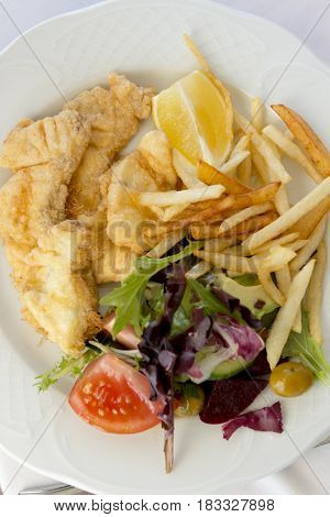 Overhead Of Fish And Chips With Salad Platter