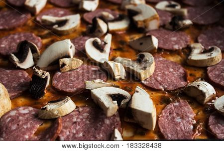 Raw Pizza With Salami And Mushrooms