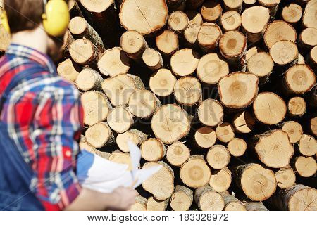 Stack of logs and lumber near by