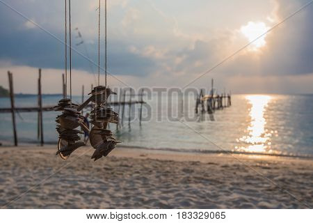 Decoration hanging mobile wooden sky of the sea background in the morning.