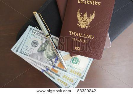 Thai passport at the airport concept travel around the world