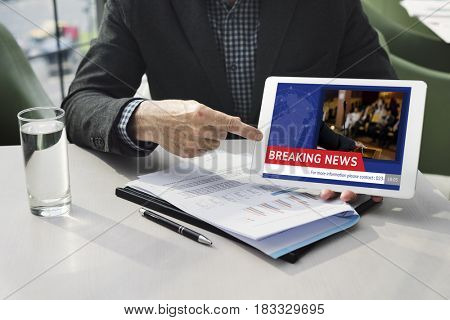 Man working on digital device network graphic overlay