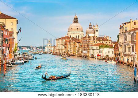 Beautiful View Of Famous Canal Grande And Basilica Di Santa Maria Della Salute At Sunset In Venice,