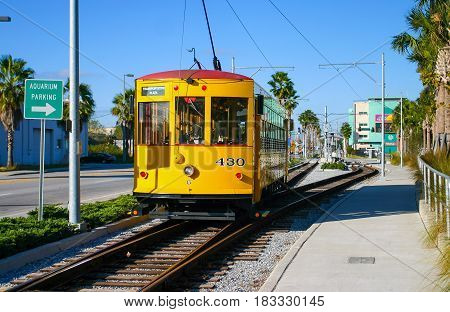 TAMPA, FLORIDA, US - November 29, 2003: Historic yellow tram at Port of Tampa on a sunny day Tampa FL