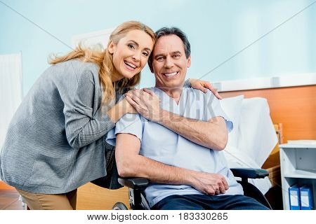 Wheelchair Man With Wife Near By In Hospital Chamber