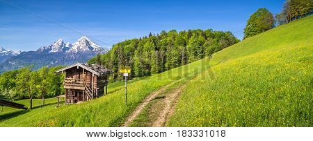 Idyllic Landscape In The Alps With Mountain Lodge In Spring