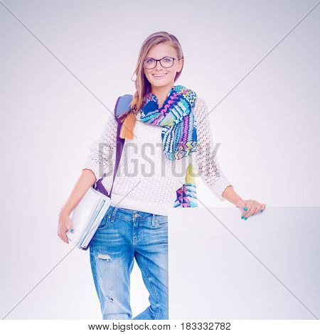 Beautiful student woman pointing on blank board.