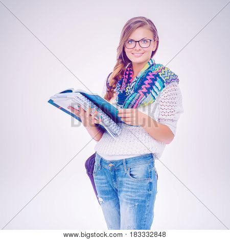Portrait of young student woman holding exercise books.