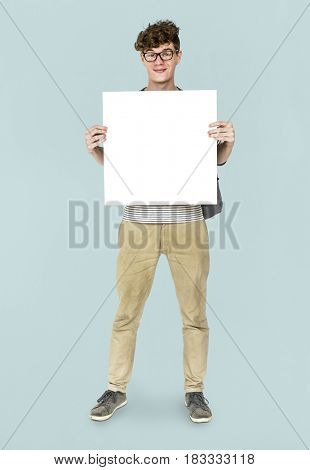 Young Adult Man Holding Blank Paper Board Studio Portrait