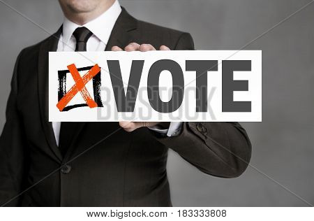 Vote sign is held by businessman picture