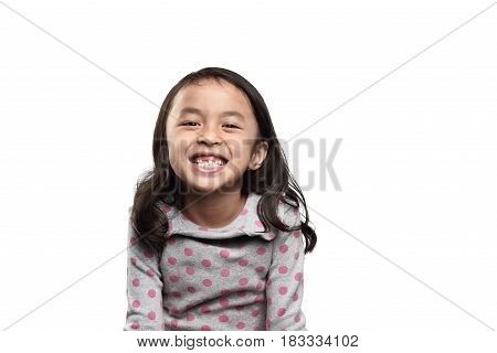 Smiling Asian Kid Showing Her Missing Tooth