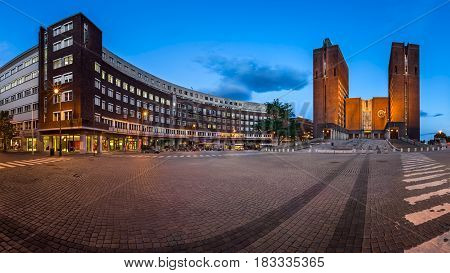 OSLO NORWAY - June 11 2014: Panorama of Oslo City Hall. The construction started in 1931 but was paused by the outbreak of World War II before the official inauguration in 1950.