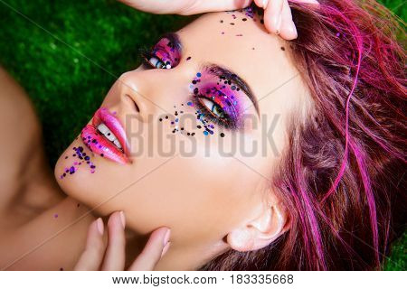 Make-up and cosmetics concept. Beauty portrait of a sexual woman with bright make-up. Hair, hair coloring.