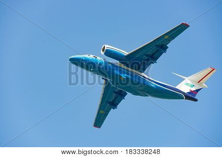 Kiev Ukraine - May 13 2014: Kazakhstan Border Guard patrol plane Antonov An-72P is taking off into clear blue sky in summer