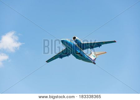 Kiev Ukraine - May 13 2014: Kazakhstan Border Guard patrol plane Antonov An-72P is taking off into clear blue sky