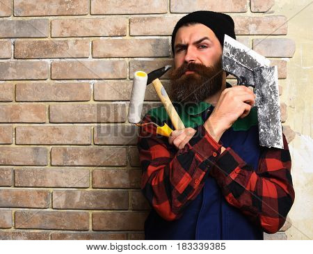 Bearded Painter Man Holding Various Building Tools With Serious Face