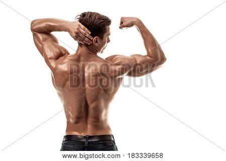 Strong Athletic Man Fitness Model posing back muscles, triceps over white background. Copy space. Isolated on white background.