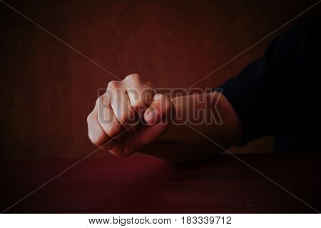 Male fist on grey background, concept in strong and fight