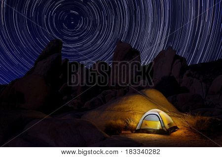Glowing Tent at Night Looking at North Star Trails in Joshua Tree National Park