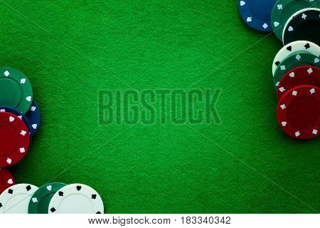 Green felt and playing chips abstract background. Poker casino and gambling theme