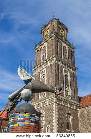 COESFELD, GERMANY - AUGUST 17, 2016: Sculpture and church tower in Coesfeld, Germany