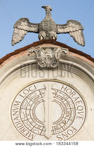 Varese (Lombardy Italy): the historic palace known as Palazzo Estense hosting the town hall. Sundial and statue of eagle poster