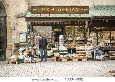 Altoetting,Germany-April 23,2017: A man looks at devotion articles outside a store at Kapellenplatz square