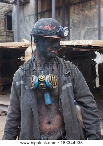 Dzerzhinsk Ukraine - August 20 2013: Miner working on a jackhammer from the Dzerzhinsky mine after work