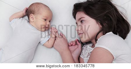 Siblings Sister With Newborn Baby Brother