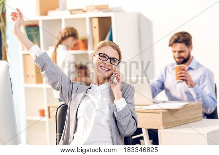 Woman Working In Home Office, Happy Businesswoman Using Smartphone With Businessman And Daughter Beh