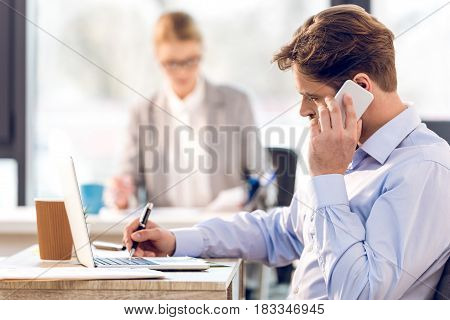 Bearded Businessman And Attractive Businesswoman Working In Office, Selective Focus